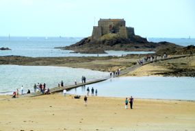 Visitors leaving the Grand Bé as the tide comes in, St-Malo, Brittany, France