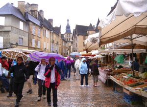 Sarlat market in the rain, Dordogne, France