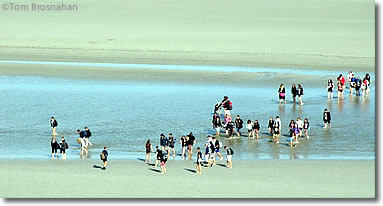 Walking on the sand at low tide, Mont St-Michel, Normandy, France
