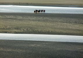 A group learns about the Bay of Mont-Saint-Michel, Normandy, France