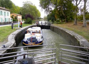 Boat in a lock on the Canal du Midi, France